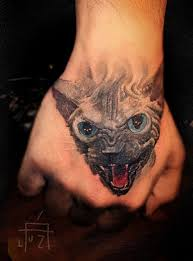 aggressive black cat tattoo on hand tattoos book