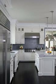 white kitchen cabinets with glazed blue backsplash tiles