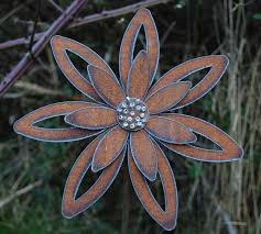how to make metal flowers for the garden rusted flower garden art