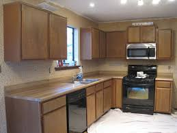 can you paint formica kitchen cabinets kitchen cabinets i painted my kitchen countertops the ugly duckling house