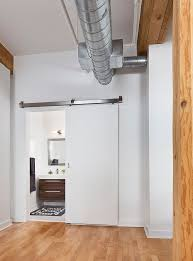Rustic Industrial Bathroom by 15 Sliding Barn Doors That Bring Rustic Beauty To The Bathroom