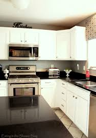 Granite Kitchen Makeovers - black and white kitchen remodel with painted cabinets