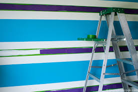 fun with disney paint striped accent wall