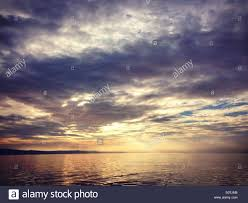 rays of sun through clouds on sea stock photo 310328152 alamy