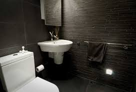 attractive 1 bathroom with floors on black tile flooring in