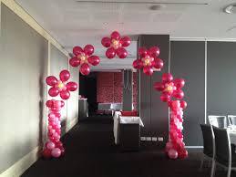 helium flower arch with mini corinthian columns for a baby shower
