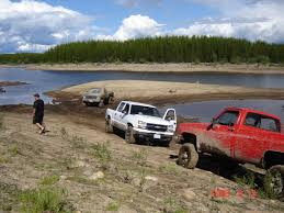 mudding trucks mud bogging and other ways we love the land too hard building