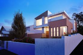 addition of geometric alucobond creates modern exterior for