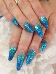 jade and blue glitter acrylic stiletto nails gel nail
