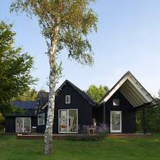 summer c cabins a cluster of five gabled cabins make up this summer retreat in