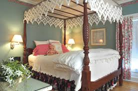 Wood Canopy Bed Frame Queen by Black And Brown Wooden Canopy Bed With White Curtain Placed On