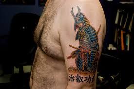 colored samurai tattoo on man left half sleeve