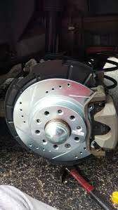 how to replace rear rotors and pads on a dodge dart