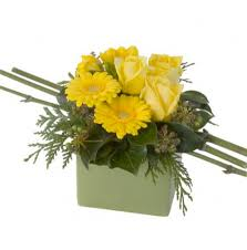 yellow flower arrangement in ceramic container wow floral