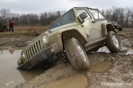 white jeep stuck in mud 5 common 4x4 myths debunked drivingline