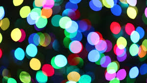 colorful defocused bokeh christmas lights blinking on a christmas