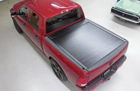 nissan frontier bed extender amp research bedxtender and pace edwards bedlocker electric install