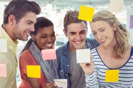 Post Office Casual Creative Team Using Post It Notes In Casual Office Stock Photo