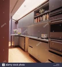 Modern Galley Kitchens Modern Galley Kitchen With Stainless Steel Splashback And Grey