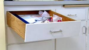 kitchen cupboard with drawers how to fix a sagging kitchen drawer by installing a runner