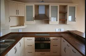 impeccable cream kitchen cabinets along with cream colored kitchen