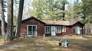 lakefront home on crooked lake for sale atlanta michigan log