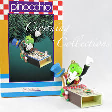 enesco all tucked in jiminy cricket in matchbox bed disney