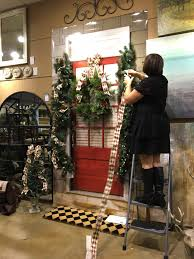 ballard designs holiday event making the most of every day the garland comes prelit with battery operated lights she flanked the door with a small tree and two deer