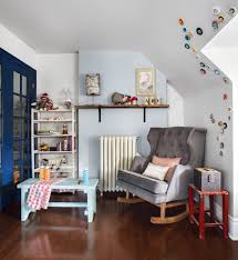 sumptuous rocker glider in eclectic boston with toddler playroom
