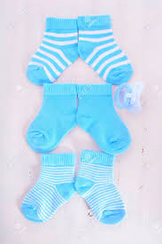 baby shower pacifiers its a boy baby shower or nursery concept with socks and pacifier