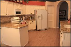 cream colored kitchen cabinets with appliances