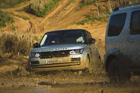 land rover mud suzuki jimny vs range rover 15k and 100k off roaders do battle