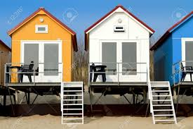 yellow blue and white beach houses in vlissingen stock photo