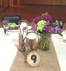 Wedding Centerpieces Floating Candles And Flowers by Wedding Centerpiece Using A Trio Of Glass Cylinder Vases Floating