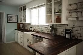 white tile kitchen butcher block with clean crisp white kitchen