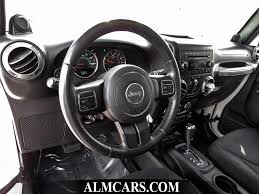 white and black jeep wrangler 2014 used jeep wrangler unlimited sport at alm gwinnett serving