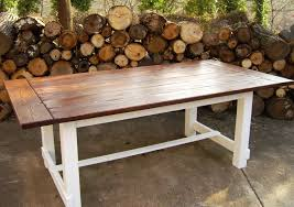 farm style outdoor dining tables with reclaimed wood trestle style