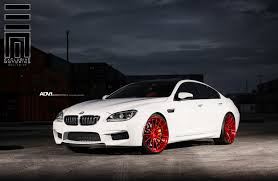 cars bmw red white bmw m6 gran coupe dares to put on gloss red wheels
