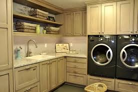 utility room layout ideas with white washer machine and cabinet