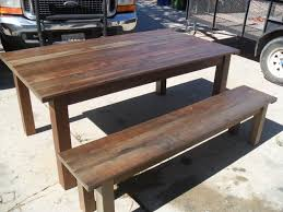 hand made reclaimed wood dining table and bench custom made in the
