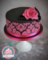 two tier pink black and white cake with tone on tone piping