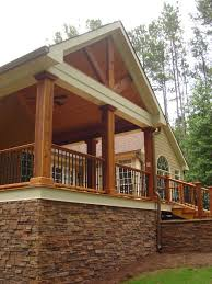 love the front porch and the stone traditional porch covered