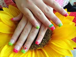 full set of acrylic nails with bright pink and green polish with