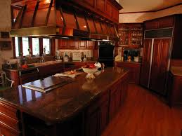 l shaped brown wooden cherry kitchen cabinet with steel sink and