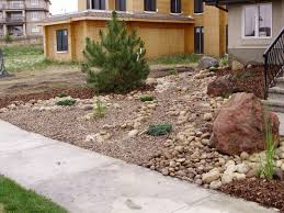 landscaping rock for brown house red brick trim colors