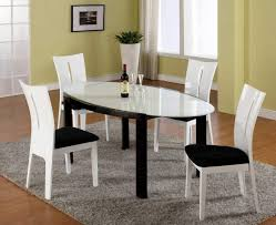 beautiful white round glass dining table with white chairs using