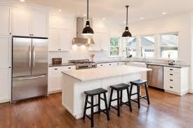 white kitchen black island tile top on the floor white wood floors black wooden
