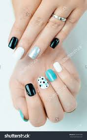 female hand trendy manicure nail design stock photo 533347768