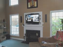 fireplace hang tv over fireplace mounting tv above fireplace