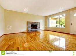large empty living room interior with brick fireplace and polis